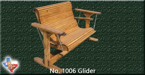 An adult wooden glider, seats two, from Sawdust and Sprinters Wood Outdoor Furniture made in Gatesville, TX USA!